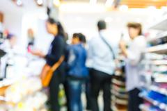 Blur people shopping in supermarket or convenience store - stock photo