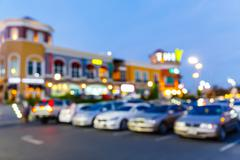 Blurred outdoor car park in the evening - stock photo