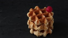 Belgian waffles with raspberries and sugar powder over rusty surface Stock Footage