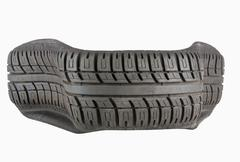 Irregular Shape of Automobile Tire after Blowout Stock Photos