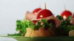 4 small delicious open sandwiches with sausage and greens on a white background Stock Footage