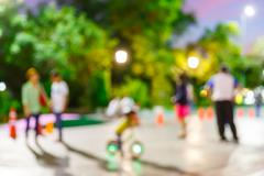 Blur people walking in community mall at night - stock photo