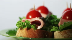 4 small delicious open sandwiches with sausage and greens on a white background - stock footage