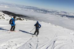 Freestyle skiing in the mountain cloudy sky Stock Photos