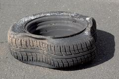 Dirty Deflated Damaged Tire on Metal Rim after Blowout Stock Photos