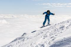 Freestyle snowboarder in the mountain Stock Photos