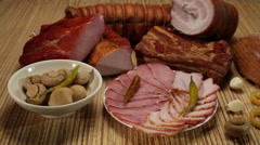 Pork bacon and marinated vegetables on a wooden board - stock footage