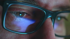 mature adult man with glasses who works at night. Close up shot, display reflect - stock footage