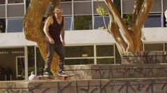Skateboarder performing nosegrind trick on the step Stock Footage