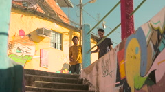 Two funky young friends shaking hands while climbing down the steps Stock Footage
