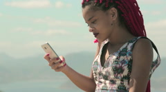 Funky young woman typing a text message on the phone Stock Footage