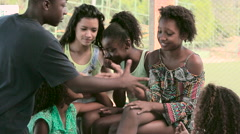 Boy greeting a group of teenage girls - stock footage