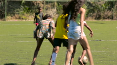 Group of children playing football - stock footage