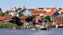 Red wooden buildings of the small fishermen town of Fjallbacka, Sweden. Stock Footage