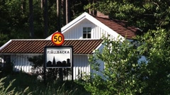 View to the road sign in the small fishermen town of Fjallbacka, Sweden. Stock Footage