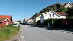 Car pass by the street in the small fishermen town of Fjallbacka, Sweden. Stock Footage