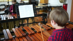 Kid studying percussion instrument marimbaphone Stock Footage