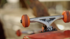 Skateboarder spinning the wheels of skateboard Stock Footage