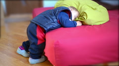 Cute sleepy baby fall asleep in a funny position Stock Footage