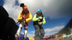 Couple street dancers having fun at winter ski slope party Stock Footage