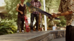 Skateboarder banging his skateboard on a step - stock footage