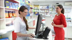 Young female pharmacist showing medical products Stock Footage