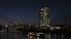 EZB (European Central Bank) Frankfurt and River Main at night, time lapse Stock Footage