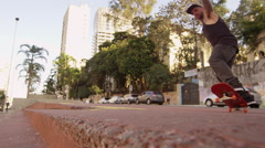 Skateboarder performing an back wheelie Stock Footage