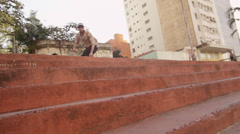 Skateboarder performing an ollie Stock Footage