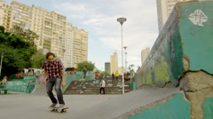 Skateboarder performing an Kick flip Stock Footage
