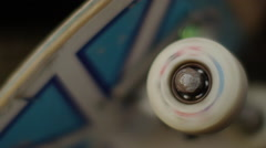 Spinning wheel of skateboard Stock Footage