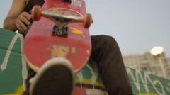 Skateboarder holding a skateboard Stock Footage