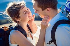 Happy bride and groom smiling closeup. Honeymoon in Alpine mountains Stock Photos