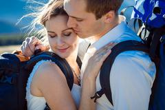 Portrait of young happy tourist wedding couple in Alps close up - stock photo