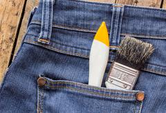Two paint brushes in jeans pocket - stock photo