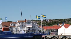 View to the buildings and harbor in the town of Smogen, Sweden. Stock Footage