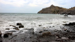Beach and ancient crumbling mountains of Crimea Stock Footage