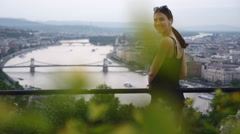 Young Girl Smiles Into Camera On The Hill Slow-motion - stock footage