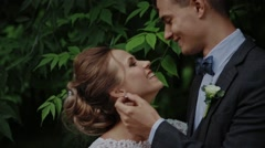 Groom gently touched to the bride on a garden background Stock Footage