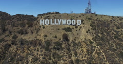Buzz Straight over the Hollywood Sign - stock footage