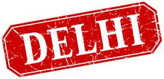 Delhi red square grunge retro style sign - stock illustration