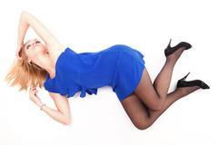 Stock Photo of woman lying lovely girl in blue dress over white