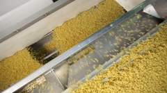 Macaroni falling down in a la carte machine - stock footage