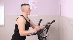 Man train on an elliptical trainer Stock Footage