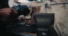 Craftsperson skillfully working a grinder in a grungy workshop Stock Footage