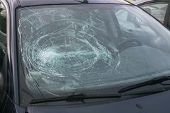 Smashed windshield of a car Canada North America - stock photo