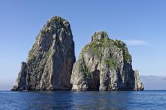 Faraglioni stacks symbol of the island of Capri Gulf of Naples Campania Italy - stock photo