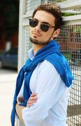 Fashion model male front fence - stock photo