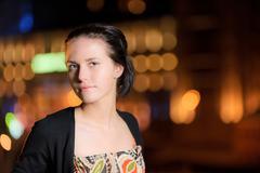 Portrait of girl against night city - stock photo