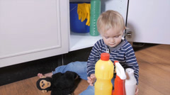 Child with household cleaners Stock Footage
